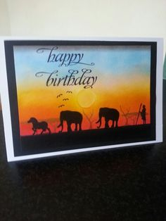Elephants at sunset using Clarity Stamps.