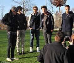 Back to the day job: One Direction were seen filming in front of The London Eye on Monday