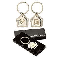 "You'll always keep your promotional ""house"" in order when your campaign includes this house-shaped center spinning keyring! With a polished trim and spinning polished finished center plate, this metal keyring opens doors to success everywhere it goes. At 1 1/4"" x 1 3/8"", this trendy giveaway is perfect for any project or event. It includes free engraving and arrives in a black gift box. Add your logo and watch heads ""spin&quot..."