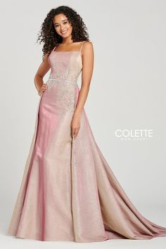 Colette for Mon Cheri CL12035. Sleeveless novelty lame a-line gown with a scoop neck, beading around the natural waist, open back, horsehair hem and a full train.