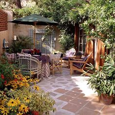 Walls that divide properties in older suburbs or on narrow city lots also can serve as walls for outdoor rooms, turning a patio into an enclosed courtyard.     Here a tile fountain set into the back wall provides a focal point