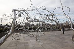 walk around and then lay down in the middle of this beautiful Roxy Paine sculpture at the Metropolitan Meseum of Art, NY