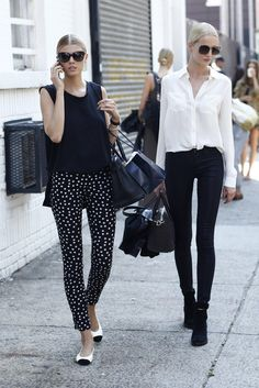 This Is It — A Look Back at the Year's Best Street Style : Color-coordinated model friends in two equally chic white and black looks — how sweet are those polka-dot pants?