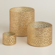 A delicate lace design allows candlelight to flow through our antique gold hurricanes, creating a stunning addition to your holiday decor. Accented with medallion cutout detail, these eclectic candleholders look great arranged in multiples.