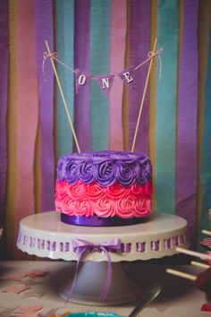 First Birthday Smash Cake, pink and purple smash cake, see more first birthday party ideas at http://www.eventcrush.com/addys-first-birthday-party/ Photo by www.catdossett.com