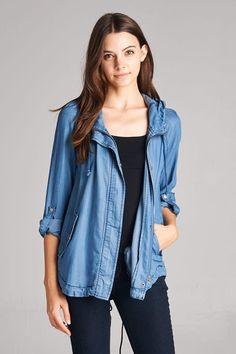 Obsessing over this hooded denim jacket! Wear it year round, because it is lightweight and the sleeves have a roll tab. Features a hidden zipper placket and a draw string back. 100% Tencel
