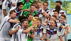 German players celebrate with the trophy after winning the World Cup final soccer match between Germany and Argentina at the Maracana Stadium in Rio de Janeiro, Brazil, Sunday, July 13, 2014. Mario Goetze volleyed in the winning goal in extra time to give Germany its fourth World Cup title with a 1-0 victory over Argentina on Sunday
