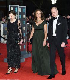 Handsome couple: Beside her, the Duke looked sharp in a black tuxedo, worn with velvet sli...