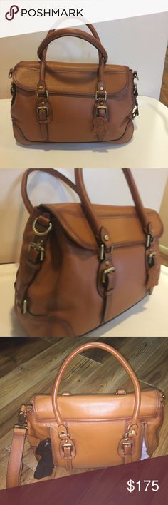 Concealed Carrie leather handgun handbag Real brown leather. Brand new. Never used. Magnetic closure. Medium bag . Beautiful!!. Shoulder strap is included & dust bag concealed Carrie Bags Satchels