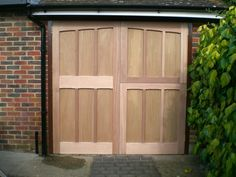 Bespoke garage doors with one side as stable door - by BMC Carpentry and Construction www.bmc-construction.co.uk Stables, Carpentry, Bespoke, Tall Cabinet Storage, Home Improvement, Garage Doors, Construction, Furniture, Home Decor