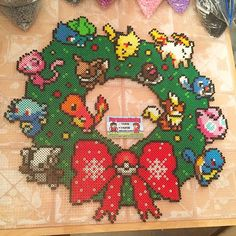 Pokemon Christmas wreath perler beads by tyler_plurden (That is awesome I want one) Cute Crafts, Bead Crafts, Diy And Crafts, Pearler Bead Patterns, Perler Patterns, Modele Pixel Art, Pokemon Perler Beads, Diy Broderie, 8bit Art