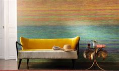 """Elitis Panama Divali is a large scale striped panoramic wall covering mural that creates a rainbow of colors on the wall. Embossed textured vinyl wallpaper with a grass cloth texture.   Sold by 3 panels of 39"""" width X 118"""" height roll"""