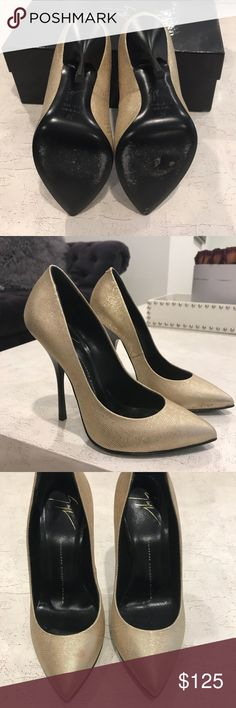 Giuseppe Zanotti gold pump size 36 Authentic Giuseppe Zanotti gold heels. Size 36. Right heel has a small stain by the front of the shoe. (See pictures for detail) sings of wear but otherwise in good condition (aside from stain)  heel size is 120mm. Giuseppe Zanotti Shoes Heels