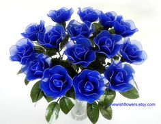 Decorative artificial blue rose for home decor. Handcraft by nylon fabric flower. Floral arrangement.