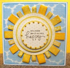 handmade card ... blue, yellow and white ... stylized sun from layers of circles and folded paper strip rays ... bright and  happy ... great background paper with fluffy blue clouds ...