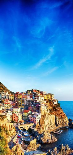 Colorful houses of Manarola Cinque Terre under a blue sky, Liguria, Italy | 15 Most Colorful Shots of Italy