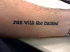 "Text tattoo - ""run with the hunted"" (quote from ""My Doom Smiles At Me"" by Charles Bukowski)"
