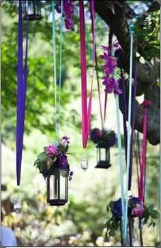 lanterns hanging in the trees from ribbons with pretty flowers around them-Another twist on the Lanterns in trees.