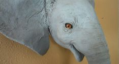 Use this pattern to create a realistic baby elephant wall sculpture. This life-sized elephant faux trophy mount is easy to make with the pattern and paper mache. Paper Mache Projects, Paper Mache Clay, Paper Mache Sculpture, Wall Sculptures, Elephant Template, Elephant Pattern, Animal Masks, Animal Heads, Elephant Head