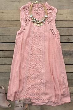 Our Me And Tennessee Dress is perfect for any occasion! It's a sleeveless dress with mock neckline and keyhole back with button closure. Mixed lace detail throughout dress. Lined for coverage.