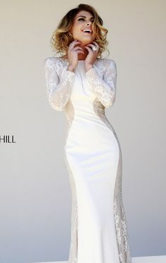 Have fun and be bold in Sherri Hill 32027. This alluring evening gown features a close neckline with V-back design. The fitted bodice flatters your gorgeous silhouette. It is embellished with beads that will make you look amazing. A full length skirt will make you sensational.