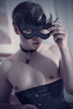 Not enough pretty pictures of pretty men in pretty corsets. I shall remedy this lack. :)