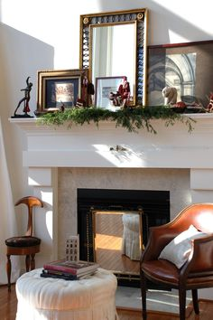 """Instead of hanging art on the wall, designer Raji Radhakrishnan of Raji RM & Associates in Brambleton, Va., likes to lean pictures of various sizes on the mantel. """"Odd numbers of things always look better than even numbers,"""" she says, """"So I would recommend three pieces of art — go to four and five only if they are really spectacular."""" For the best effect, Radhakrishnan likes to place the largest painting or drawing on the mantel first, slightly off-center, with the second and third pieces…"""