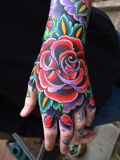 Super vibrant american traditional rose tattoo on hand1