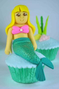 Tutorial that shows you how to make mermaid cupcake toppers out of fondant.