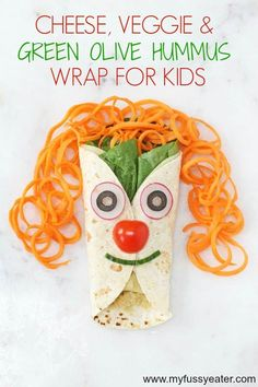 Making food that's not only fun and appealing to kids but nutritionally balanced too can be very hard work but if you serve up this delicious, healthy and fun Cheese, Veggie & Green Olive Hummus wrap for kids watch them have a giggle with their lunch whilst knowing they are eating a healthy lunch! #wraprecipes #lunchideas #funlunchesforkids #funfoodforkids Lunch Box Recipes, Wrap Recipes, Lunch Ideas, Healthy Meals For Kids, Kids Meals, Healthy Foods, Hummus Wrap, Super Healthy Kids, Fussy Eaters