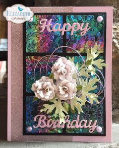 Selma Stevenson created her card with Susan's Garden Club Garden patch 1 1/2 inch & Mini Roses die cut in Shimmer Sheetz, and embossed with our Spring Leaves embossing folder. Selma also used our Silk Microfine Glitter and Els van de Burgt Studio Happy Birthday die. Selma used Susan's Garden Notes Rose 2 with Susan's Garden Woodland Leaves as the centerpiece. Find the supplies here: https://www.elizabethcraftdesigns.com/