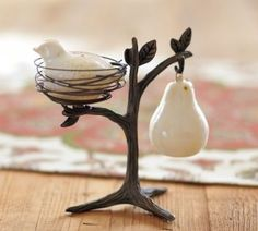 Partridge in a Pear Tree Salt and Pepper from Pottery Barn.  Found these locally and they're cute. The partridge sits kind of crooked in the nest, not as shown in the pic.  Pretty but didn't think it was worth the   $39.95 price tag. ♥♥♥