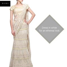 Flaunt this pristine lehenga saree for a fantastic look. Click here to have a look: http://bit.ly/KalkiCreamSaree
