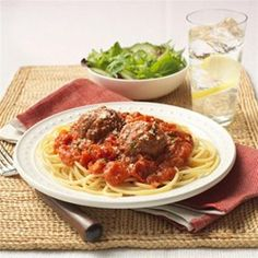 A pasta recipe with homemade Parmesan meatballs in a chunky seasoned tomato sauce.