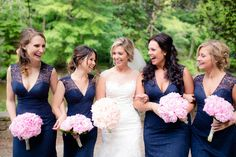 Gorgeous Navy Bridesmaid Dress coordinated with blush pink bouquets