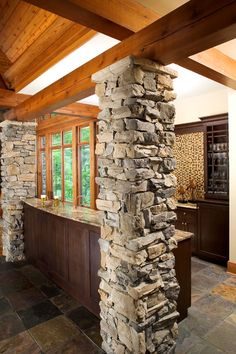 Added bar area. Like windows, stone and wood beaming.