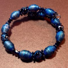 Memory wire bracelet made with hand painted paper beads