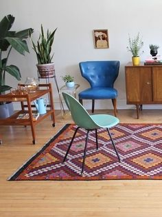 The elements of colorful vintage modern style: sleek Midcentury pieces, rich and textured rugs, plenty of plants and personal curios.
