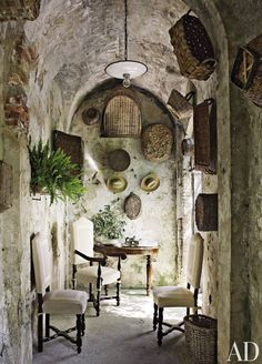 Rustic Outdoor Space by Dede Pratesi in Tuscany, Italy - like the hanging baskets on the wall and what a great escape from the hot sun. Rustic Outdoor Spaces, Rustic Patio, Rustic Entryway, Outdoor Rooms, Style Toscan, Interior And Exterior, Interior Design, Stone Interior, Interior Ideas