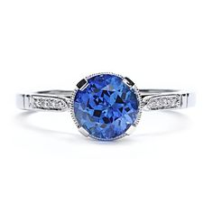 An enchanting, deep blue sapphire gem is surrounded by luxurious pave diamond details in this vintage-inspired cocktail or alternative engag...