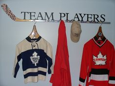Use a hockey stick and wooden pegs to create a cool hanger for your hats and jackets.This is the one that we made for my little boys hockey theme bedroom.