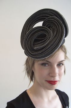This one I made for the Dubai World Cup in 2007, a straw spiral set on a small beret.~Serena Lindeman