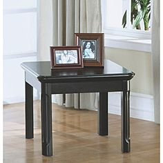 @Overstock - As an update for a seating or conversation area in your home, this modern black end table has graceful lines and concave detail on the legs. Perfect for a reading lamp or family photographs, this piece adds grace and style without overtaking your room.http://www.overstock.com/Home-Garden/Distressed-Black-Veneer-End-Table/6694923/product.html?CID=214117 $159.99