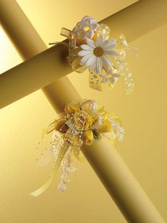 Yellow and white daisies light- up wrist corsage (upper right) Yellow spray roses accented with pearls rhinestones