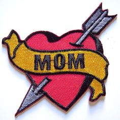 This is an auction for:One MOM Heart Tattoo iron on patch. One red heart and MOM banner tattoo patch. Iron on backing. Embroidered. 3 inches. Want more pictures? Just ask!