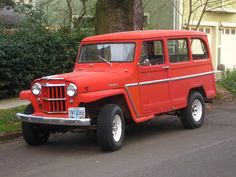 OLD PARKED CARS.: 1961 Willys Jeep Overland Station Wagon.