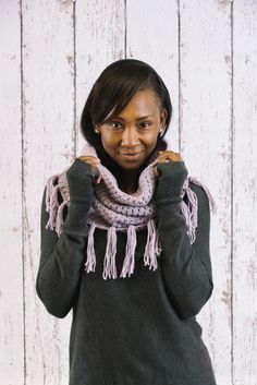 As the weather turns warmer as we head into spring, this tasseled scarf is the perfect way to stay warm on those chillier afternoons. Plus, it's perfect for adding a touch of bohemian charm to whatever outfit it's paired with.
