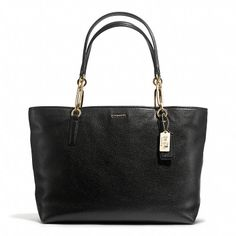 found my new work bag! Coach black pebbled leather tote with gold details. Classic chic and roomy.