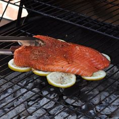 Grill your fish (OR CHICKEN) on a bed of lemons to infuse flavor & prevent sticking to the grill. GREAT idea!