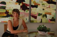 Flora Bowley relaxes in front of one of her paintings during a recent visit to the Green Bay home of her parents.
